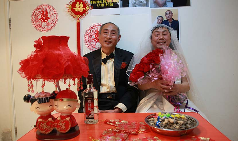 Two older men hold a symbolic wedding ceremony in Beijing, Jan. 30, 2013. ChinaFotoPress/VCG
