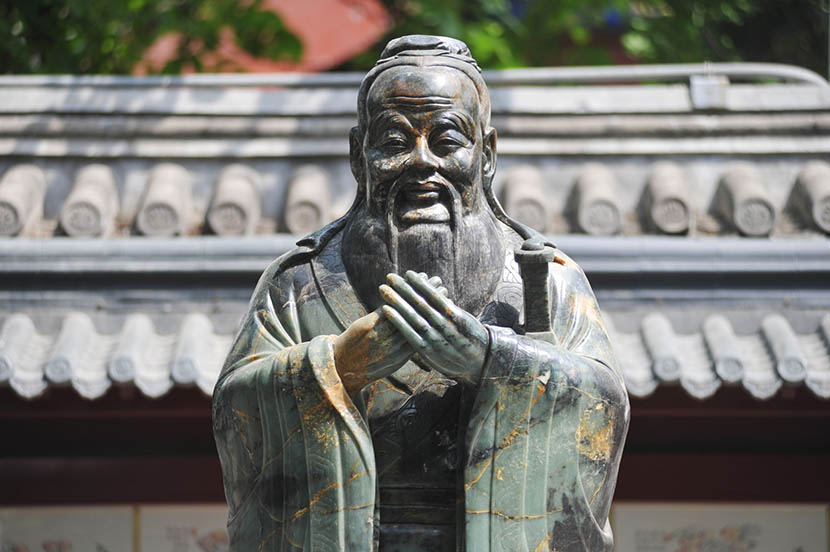 A statue of Confucius at the Confucius Temple in Beijing, May 18, 2015. Mai Tian/VCG